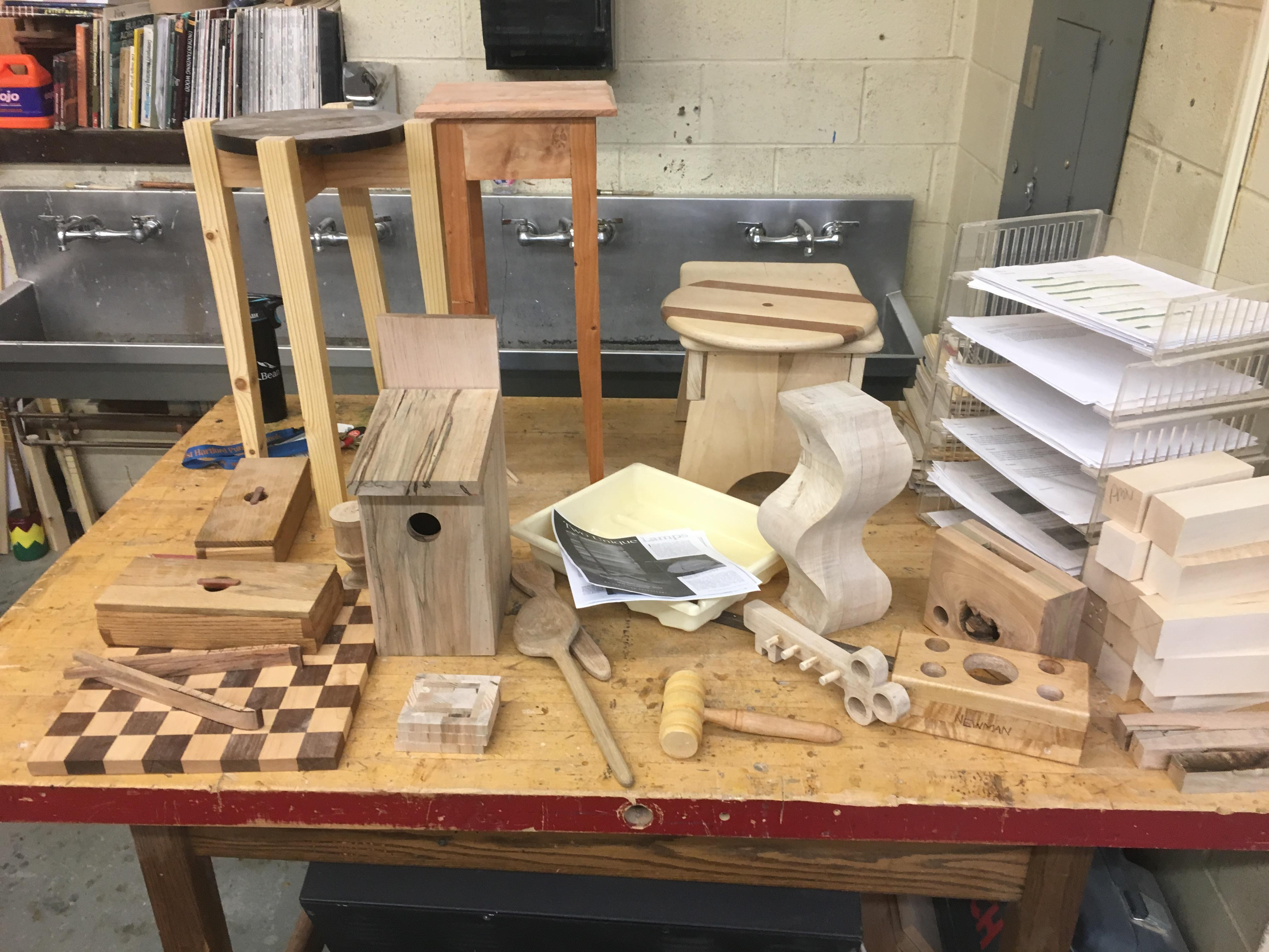 Photograph displays some of the projects a Woodworking student can make.