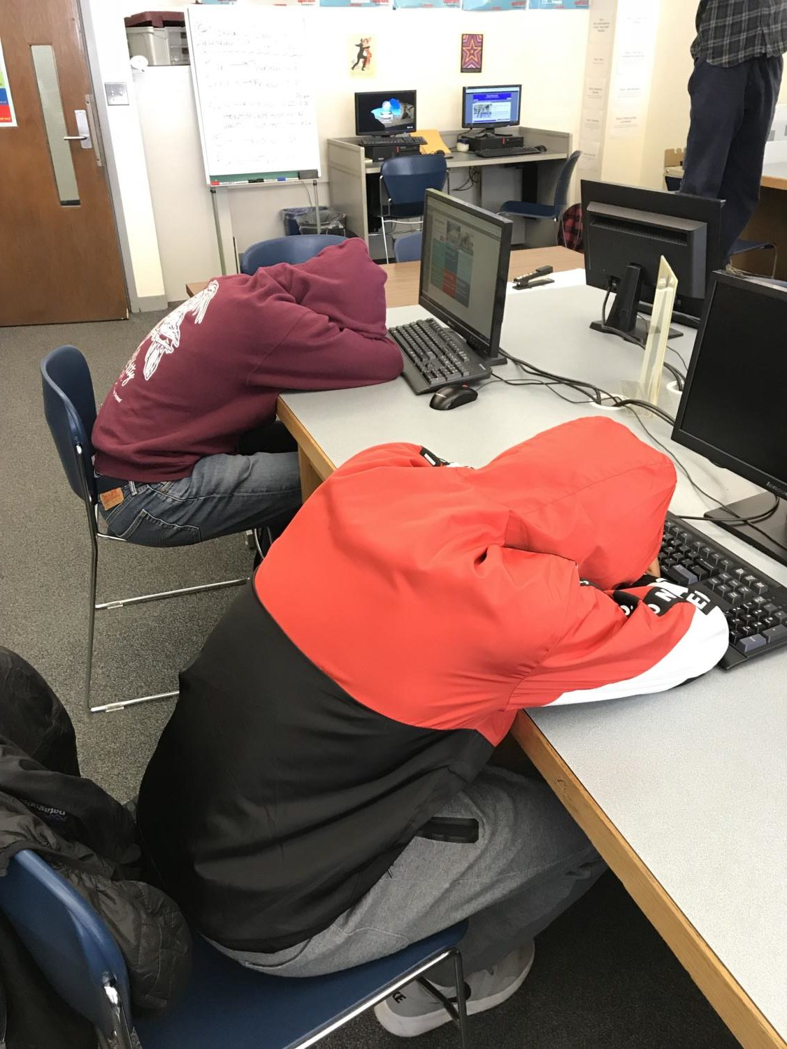 These students are falling asleep in class because they woke up so early.