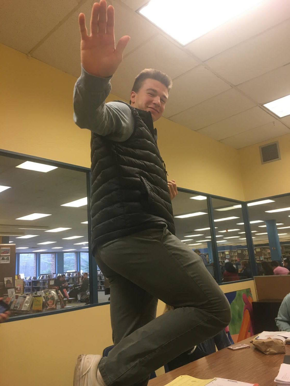 Senior, Max Congdon practices his Heisman pose.
