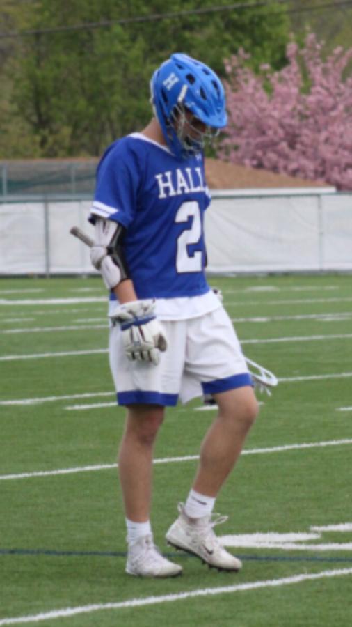 Nolan playing lacrosse.