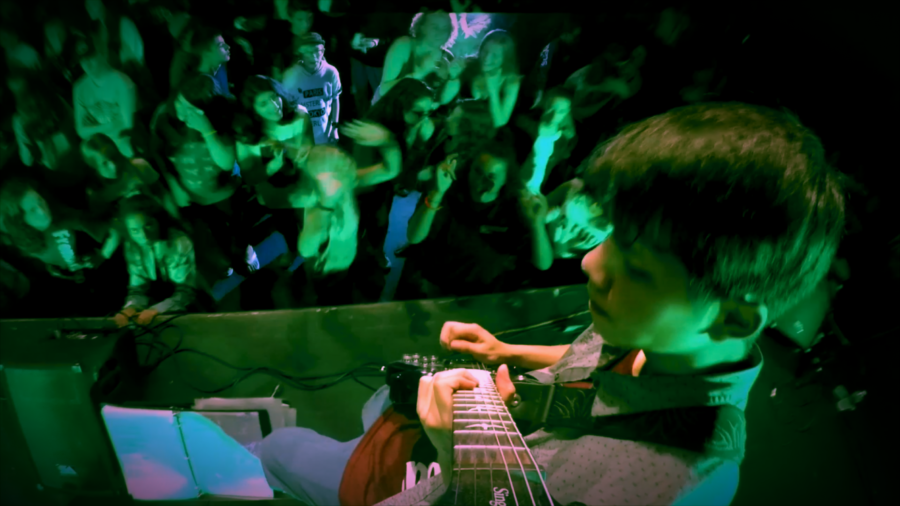 Brennen Ravenberg taking a guitar solo at a show his band did in New York.