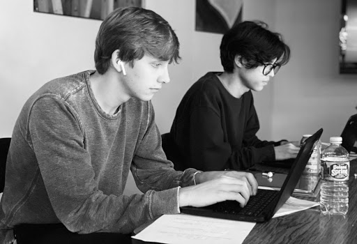 Zach Martin and Carlos Flores studying using computers