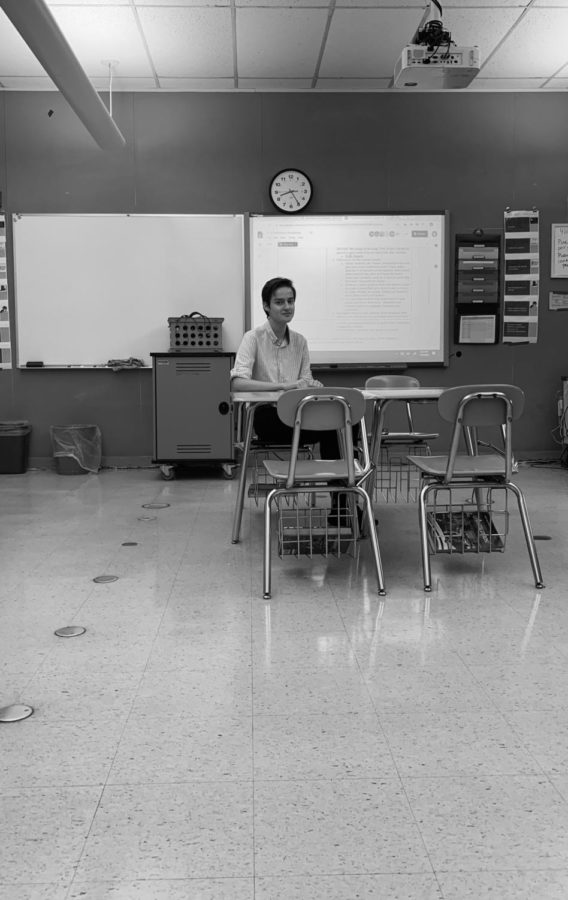 Senior student, Alexei sitting in classroom.