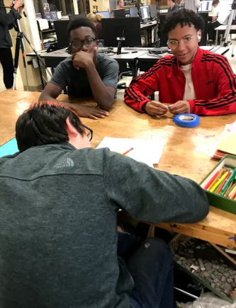 Students are shown working hard in class