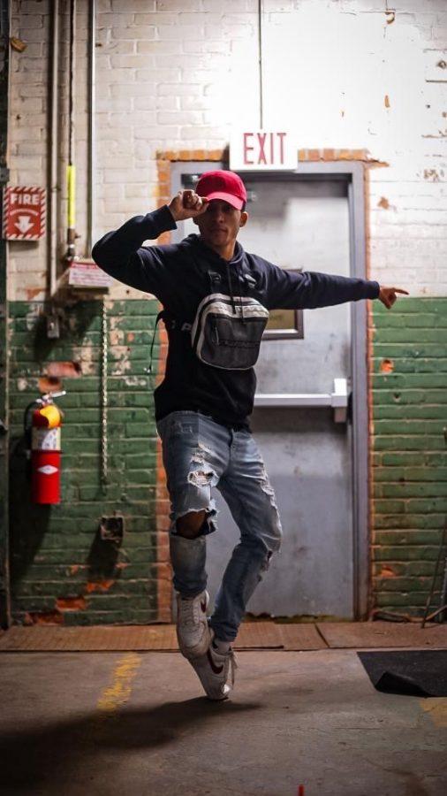Jayden posing in a toe stall.