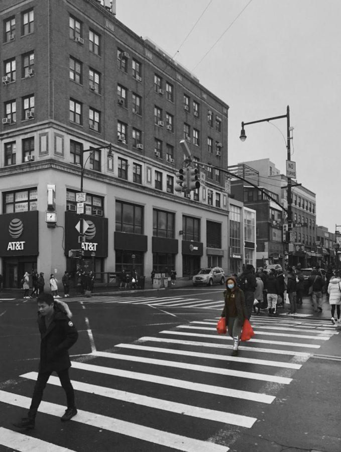 A woman walking across the street.