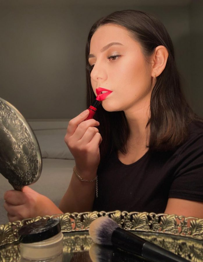Finishing up the makeup with a red lipstick