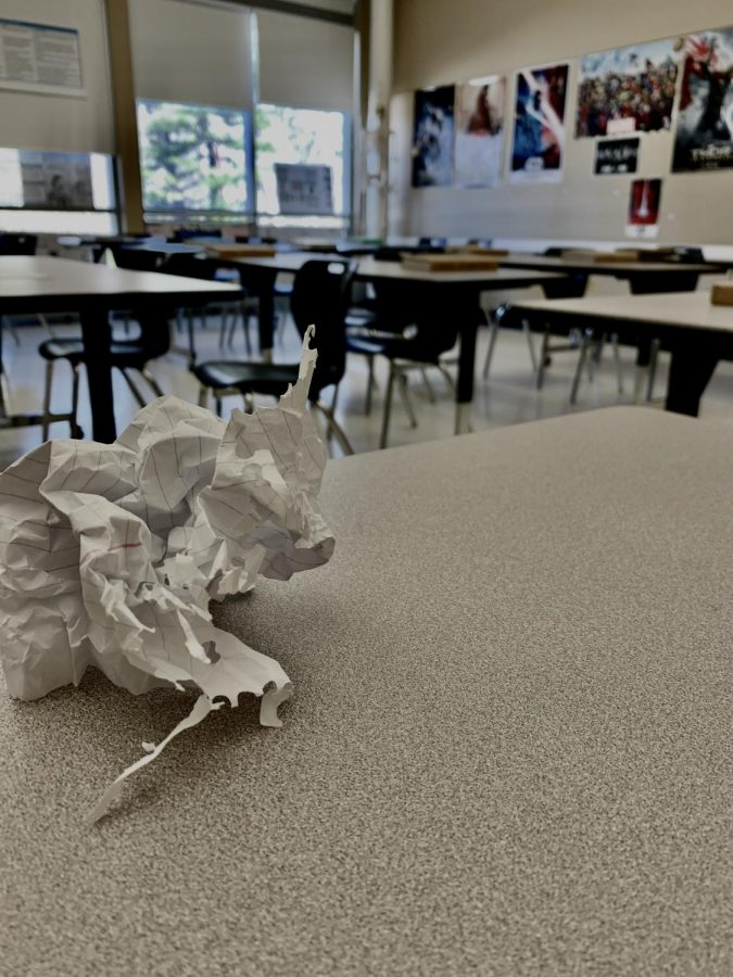 A+piece+of+paper+on+the+table+of+a+classroom.+
