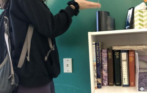 """Here is Anabel Dease '22 making a TikTok in the middle of study hall. It seems she is doing the """"renegade"""" dance."""