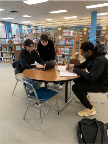 This photo was taken by Sami Farber in the Hall High School Library where students are seen working really hard on their homework.