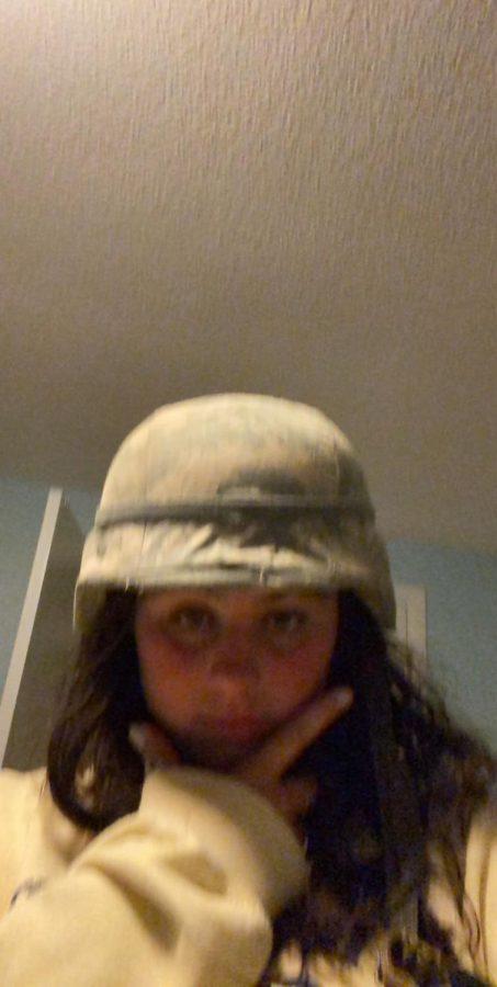 Lola with an army helmet on