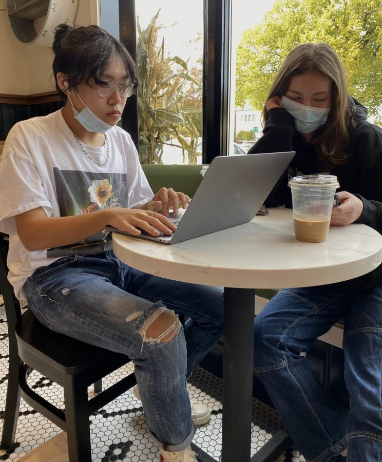 Phillip Nguyen (left) and Megan Goldfarb (right) enjoy each other's company while they work on schoolwork and take in the bustling atmosphere.