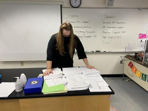 A high school math teacher looks at all the papers she has to grade as she stresses over the new schedule.
