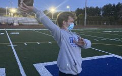 Hall High School Varsity Quarterback Brooks McConnell practicing with his mask on following CDC guidelines