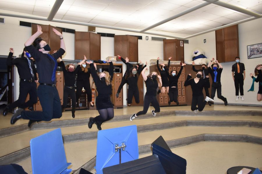 In this photo, the Hall Choraliers pose for a High School Musical style freeze frame photo in the choir room at Hall High School, West Hartford, CT while filming for Pops 'n Jazz. The personality of each member becomes visible and their excitement is evident throughout the various ways they decide to jump. (Taken March 1. 2021)