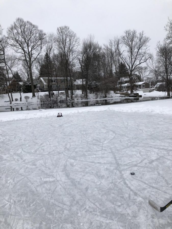 Hall Southington shovels frozen pond to get in an extra day of practice