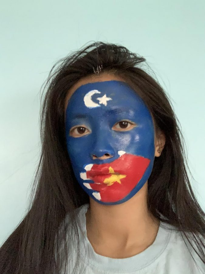 Turkey protesters painted  the flag of Turkey and China to show the unionism for Uyghurs: Uyghurs are Turk and Chinese.