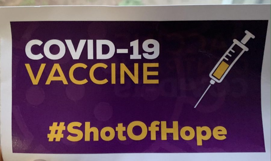 A flyer displays the advertising of the COVID-19 vaccine in the the U.S.