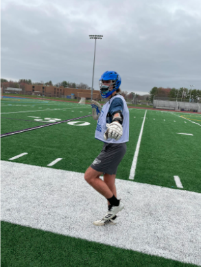 Senior lacrosse player Luke Duzan practices with a mask on due to the Covid-19 pandemic.