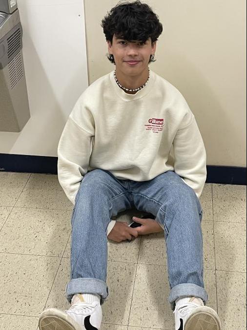 Jackson Sitting in the hallway
